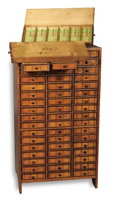 Patek-Philippe-Antique-Tool-Cabinet. Exquisite wooden cabinet is an original watchmakers chest from the late 1800's that was once used by Patek Philippe. Made of real wood, this beautiful chest boasts of 51 individual drawers each with a hinged top. Standing tall on stile feet, this chest is also flat sided. A piece that depicts Patek Philippe's taste for luxury and craftsmanship, it is one-of-a-kind.
