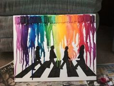 Crayon melting on the silhouette of the Beatles walking across Abbey Road.