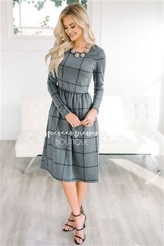 You can never have too many of our soft and comfy dresses! The thick and extra soft material is as comfortable as can be. Gray dress features a plaid print, long sleeves and side seam pockets.