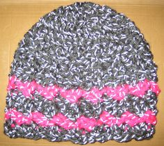 Crochet hat using Red Heart reflective yarn in grey and pink