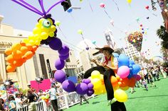 "TheSooziShow.com performing in a Balloon Puppet on Stilts at Disney's ""Up"" Movie premiere, May 2009"