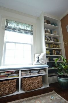 I think this is the same IKEA media/coffee table that we have.  I wonder if it would work as a window seat in the breakfast nook??  I could make a cushion for it.
