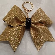 BKC - GOLD HOLOGRAPHIC METALLIC FULL (BLACK CENTER ..can be changed) CHEER BOW KEY CHAIN - **** Perfect for Fundraising ..contact me for BULK PRICING - Check out all the other styles and prints listed too! DESIGNS BY NTJ http://www.amazon.com/dp/B00LUYWSCS/ref=cm_sw_r_pi_dp_t7gfwb14XQNNV
