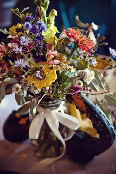 I LOVE this flower arrangement. Wildflowers. So beautiful and rustic.