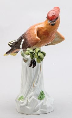 A Large Meissen Porcelain Figure In The Form Of A Bohemian Waxwing Sitting On A Tree Stump, C. 1880  Blue Crossed Swords Mark, Incised Model No. 274X, Impressed 6.       Product size 23 Cm High 9.05 inches    Catalog  7470-903