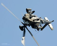 An Army Air Corps Apache of the Apache Attack Helicopter Display Team thrills the crowds at the RAF Cosford airshow.