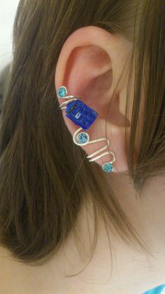 Doctor Who TARDIS Ear Cuff by 77Flower77 on Etsy, kr40.00 - I'm not quite the Dr. Who freak my kids are, but this is cute!
