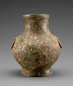 Hu vessel, Warring States period (475–221 BCE), Wei state Bronze with inlaid gold, silver, and precious stones   Baoji Bronze Museum