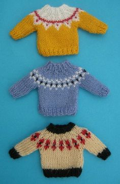 Sweaters with patterned yokes for the dolls house Knitting pattern by Helen CoxI have designed this easy to knit miniature knitting pattern for the dolls house in scale. It provides instructions to make three different sweaters with patterned yokes f Knitting Dolls Clothes, Crochet Doll Clothes, Knitted Dolls, Doll Clothes Patterns, Clothing Patterns, Knitted Baby, Christmas Knitting Patterns, Sweater Knitting Patterns, Arm Knitting