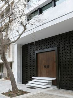 http://www.customhomeproject.com/50-modern-front-door-designs/ Not about the doors, but the wider framing around it