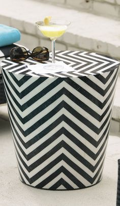 With contemporary chevron patterns, the handmade Cadiz Stool utilizes black-and-white fossilized stones to create a sleek decorating accent.
