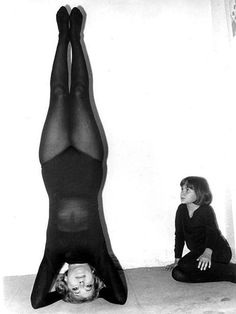 1958. Olivia de Havilland doing yoga before it was cool while in London for the English premier of THE PROUD REBEL.