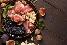 appetizer on wooden table by peterzsuzsa on Creative Market