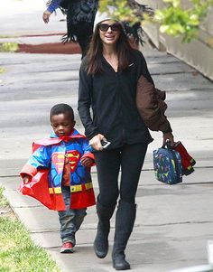 Sandra Bullock held hands with her son Louis, who sported a Superman-style raincoat, in L.A. May 6.