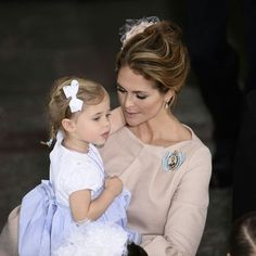Princess Madeleine of Sweden holding Princess Lenore at Prince Oscar's christening. May 27 2016