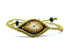 Black and burgundy beaded eye bracelet por CrazyIreneCreations