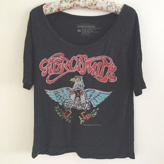 "Aerosmith Eagle Band Tee Oversized Aerosmith band tee featuring a eagle vintage print. Perfect with skinny jeans! Size small in good condition no holes/stains light wear. Fabric: cotton/poly Measurements: Length 22"" Chest 17.5"" YES to: Bundle Discounts NO to: Trades / Modeling / Holds  Happy Poshing!!  Vintage Tops Tees - Short Sleeve"