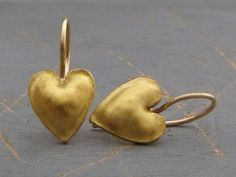Handmade and crafted with care , 22k solid gold puffy hearts earrings The back of the earrings is made of 9k yellow gold. Handmade 14k yellow gold locking French wires. Earrings Width - 0.4( 10 mm). Length without the ear wire - 0.6 (15 mm). Length from top of the ear wire to bottom of the earring