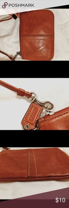 Coach wristlet - Blood Orange This is a used blood orange coach wristlet. My iPhone 6S fits perfectly inside. It's clearly been used - but it probably just needs some cleaning. I also have that black Michael Kors Wallet listed Coach Bags Clutches & Wristlets