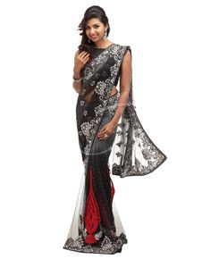 #Fancy_sarees: Twin color net fancy saree. Product Code : TS-667 INR 23,550.00 Body :Black n ash color with stone works n border, the skirt portion is of ash n black with red color thread work with border. Border :Designed with stones Pallu :Black n ash color with stone works with saree border. Blouse :Black net with stones work n also on sleeves