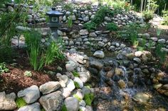 Twin Cities Pond and Landscape Tour - Plymouth Mn | Bog, Bridge, Butterfly Garden, Formal Garden, Garden Art, Lakeshore, Landscape Lighting, Perennial Garden, Pond, Shaded Area, Stepping Stones, Stone or Paver Patio, Stone Retaining Walls, Stream, Theme Garden, Waterfall, Wooded Lot