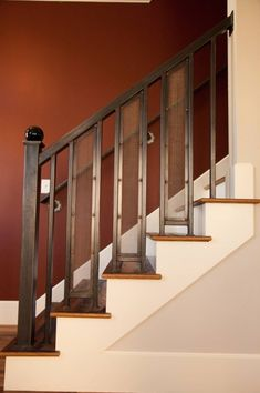banister - top of stairs - kitchen and between up/down stairs. open up the whole area. only medium oak.