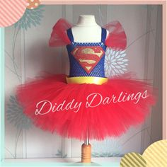 Superman Tutu Dress. Girls Superhero Dress. Special Occasion.  Beautiful & lovingly handmade.  All characters and colours available Price varies on size, starting from £25.  Please message us for more info.  Find us on Facebook www.facebook.com/DiddyDarlings1 or our website www.diddydarlings.co.uk