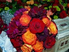 "another wedding bouquet inspiration photo. I ended up using these amazing orange ""Circus"" roses in my sister's bouquet (she was the MOH). Orange Purple Wedding, Burnt Orange Weddings, Purple Wedding Bouquets, Fall Bouquets, Fall Wedding Flowers, Fall Wedding Colors, Red Wedding, Wedding Color Schemes, Wedding Ideas"