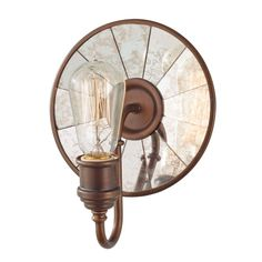 Experience old-world opulence every time you step into your bathroom furnished with this one-light wall sconce. Featuring an industrial-themed design, this wall lighting adds vintage flair to any space with the astral bronze fixture finish.