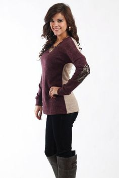 """Sequin Elbow Top, Purple/Taupe $37.00 Elbow patches are everywhere this season! We especially love this one because it features SEQUINS! We love the combination of purple and taupe in this top, just slip on jeans with it and you have a stellar outfit!   Fits true to size. Miranda is wearing the small.   From shoulder to hem:  Small - 26""""  Medium - 27""""  Large - 28"""""""