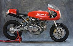 It's difficult to improve on the aesthetics of a 1970s Ducati bike. But Australian specialist Tony Hannagan of BevelTech has done it. The engine on his latest creation is from a 900SS: it's been rebuilt with Cosworth pistons, polished rods, ported heads and magnesium valve covers. It sits in an 860 GT frame that's also…