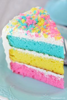 a slice of multi colored Easter cake on a plate