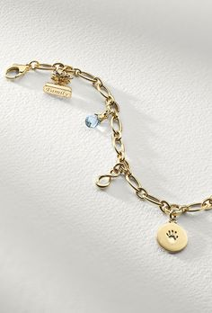 This delicate charm bracelet is forged of 18k yellow gold and features five hidden hinged links to add charms with ease as you continue to build your own story.