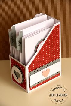 could make with old cereal box, modge podge and some cute fabric--organize cards, etc.