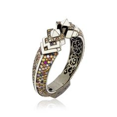 Elizabethan Crown Cuff by Matthew Campbell Laurenza. This sterling silver Two Points Armor Cuff is hand-set with 18.40 carats of multi-colored sapphires, accented by white enamel and plated with black rhodium.