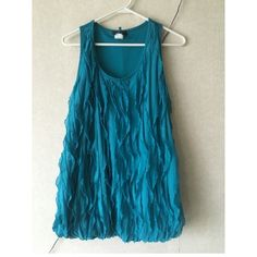 Fun dressy tank size 1X Fun flirty turquoise tank with ruffle detail that helps hide your problem areas! Worn once for a work party size 1X. Deb Tops Tank Tops