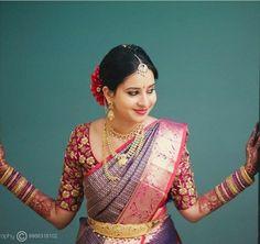 South Indian bride. Gold Indian bridal jewelry.Temple jewelry. Jhumkis. Purple pink and red silk kanchipuram sari.Braid with fresh jasmine flowers. Tamil bride. Telugu bride. Kannada bride. Hindu bride. Malayalee bride.Kerala bride.South Indian wedding.