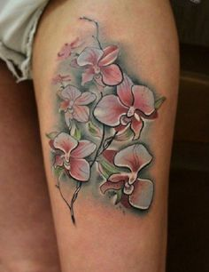 Unique Orchid tattoo. As a matter of fact, Orchids come in a variety of colors and these colors enhance their beauty.
