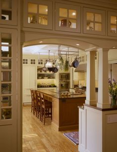 upper small decorative cabinets (lite from inside). This works well with an arched entryway into the kitchen from our family room