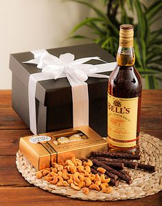 A Whiskey hamper with nuts, biltong, droe wors, chocolates and a bottle of Bells Whiskey in a gift box, available for delivery throughout South Africa. Chocolate Hampers, Gift Hampers, Gift Baskets, Biltong, Alcohol Gifts, Spice Rub, Grass Fed Beef, Gifs, Wine Bottles