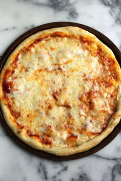 So easy to make at home and 100 times better than take-out!!! The Best New York Style Cheese Pizza EVER.