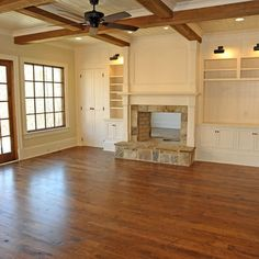 built in around fireplace love that it goes to the ceiling and the ceiling trays too! wow!
