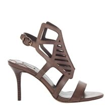 "WANESSA – SLASHED LEATHER SANDAL STYLE NUMBER: 5F01217 $298.00 This head turning shoe is designed with slashed leather panels that wrap the foot and buckle around the ankle for a look both very feminine and fierce. Their leg lengthening and comfortable 3-1/2"" heel makes day to evening wear a breeze. Fits true to size. Leon Max Collection."