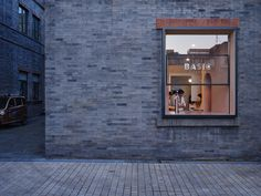 Set within a co-working hub in Beijing's gentrified commercial hub of XianYuKou, Basic Coffee by Office AIO focuses on the joy of drinking coffee. Aluminum Screen, Design Studio Office, Pink Tiles, Brick Facade, Wooden Counter, Bar Interior, Project, Co Working, Textured Walls