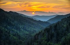 A stunning summer sunset in the Great Smoky Mountains National Park from Morton's Overlook along US-441 near Newfound Gap between Gatlinburg TN and Cherokee NC.  This overlook is the classic Great Smoky Mountains scene, offering layers of mountains ridges and valleys that stretch into the distance toward Gatlinburg TN.