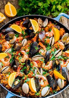 Chicken and Seafood Paella - a classic Spanish rice dish made with Arborio rice,packedwith chicken, sausage, mussels, clams and shrimp and loaded with flavor.