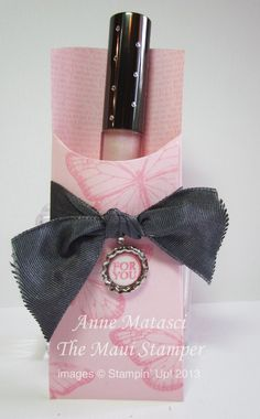Anne used Best of Butterflies to decorate this lip gloss holder made from the Petite Pocket die. Love the wee soda pop top embellishment!