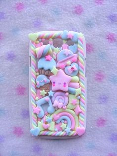 """This particular Deco-denned iPhone Case was done with only polymer clay, no silicone """"frosting"""" or blingage. I think that is very interesting and unique."""
