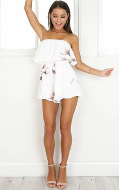 c58d5ce36c6 Gorgeous white strapless playsuit featuring a simple floral print.  Strapless Playsuit