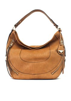 Edgy zip accents combine with luxe stitching to elevate the Kendall handbag by Jessica Simpson. Crafted in a classic hobo silhouette with ample storage for your day-to-day essentials, this gorgeous brown bag makes the ultimate statement.